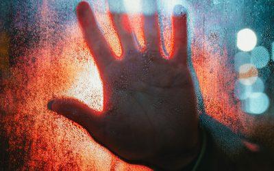 hand-touching-glass-3944752